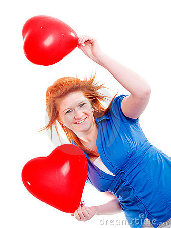 Girl holding two valentine balloon hearts