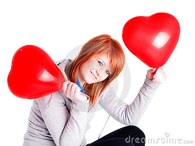 Girl holding two valetine balloon hearts