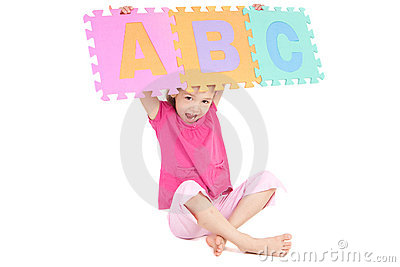Girl holding up alphabet abc sign
