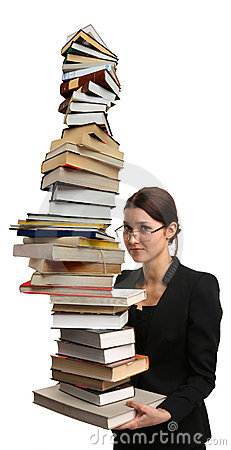 Girl holding very large pile of books