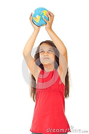 Girl holding world globe in her hands