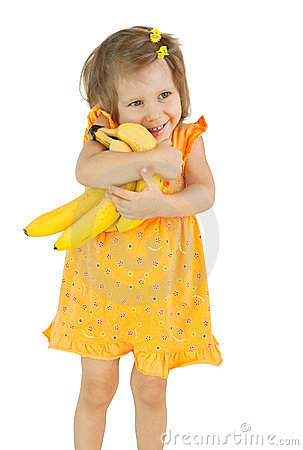 The girl holds bananas