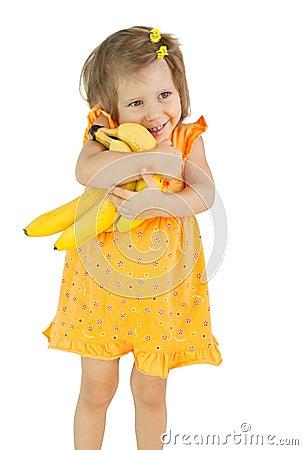 The girl holds bananas