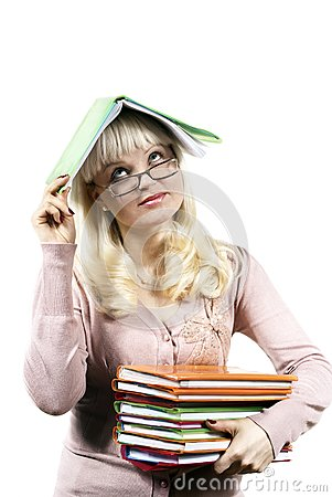 Girl holds a book on her head