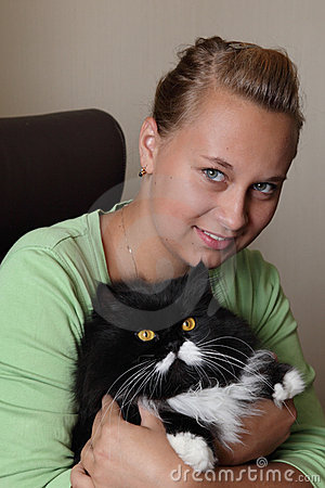 The girl holds a cat