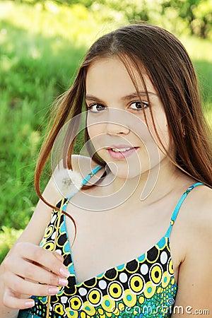 Girl holds dandelion