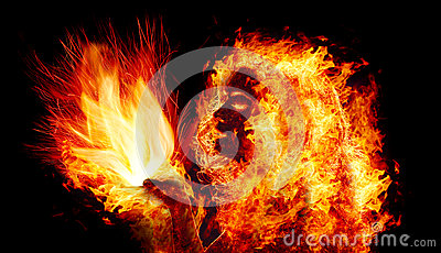 Girl holds a flame in palms