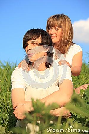 Girl holds guy behind for shoulders