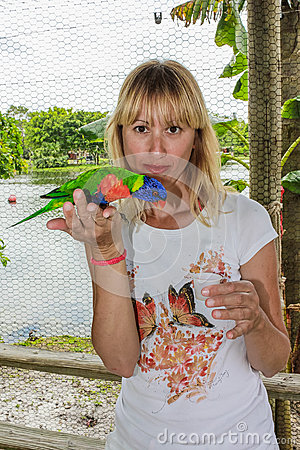 Woman touching parrot