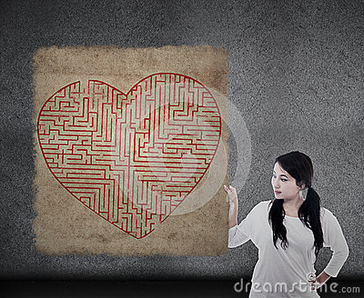 Girl holds love maze puzzle map