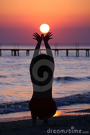 Girl holds lowing sun.