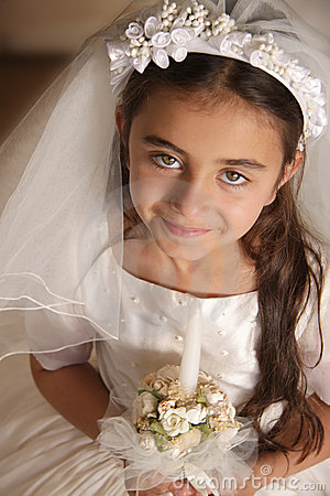 Girl in Holy Communion Dress with candle