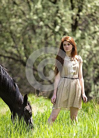 Girl and Horse in Meadow
