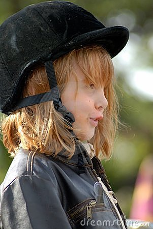 Girl with horse safety hat