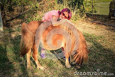 Woman with a Shetland pony