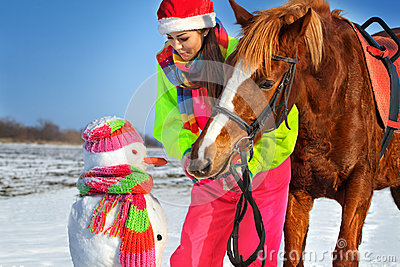 Girl, horse and snowman