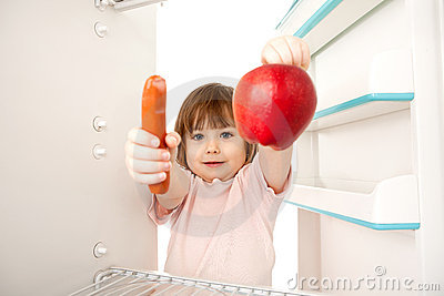Girl with hot dog and apple