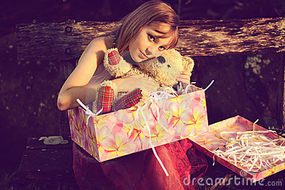 Girl hug teddy bear