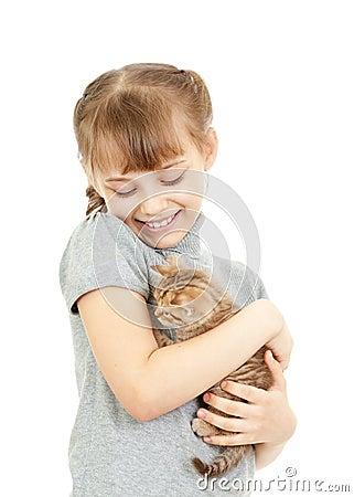 Girl hugging with British kitten