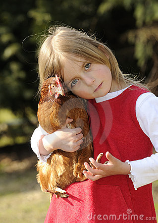 Girl hugging a chicken