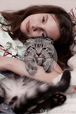 Girl hugging cute kitten