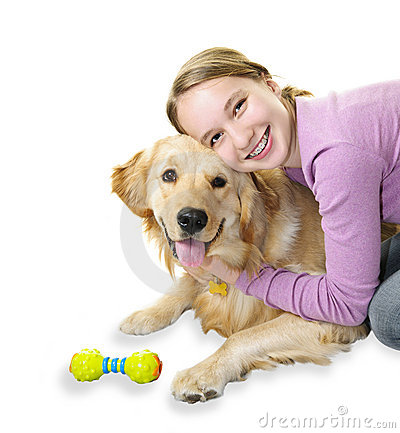 Girl hugging golden retriever dog