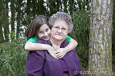 Girl hugging her Great Grandmother