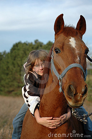 Girl Hugging Horse