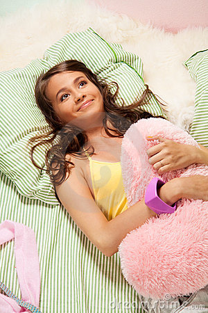 Girl hugging the pillow