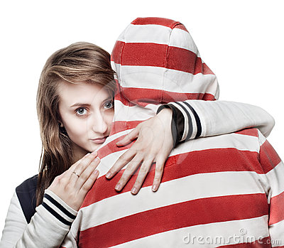 Girl hugging a young man