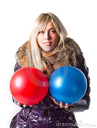 Free Girl In A Jacket Holding Balls Stock Photo - 21553140
