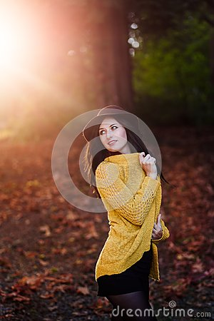 Free Girl In A Park With Autumn Leaves Around Her. Stock Image - 123878461