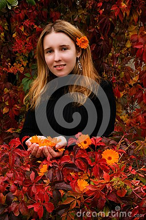 Free Girl In Autumn Garden Stock Images - 27013164