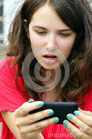 Free Girl In Disbelief Over Mobile Or Cell Phone Text Royalty Free Stock Photography - 26543007