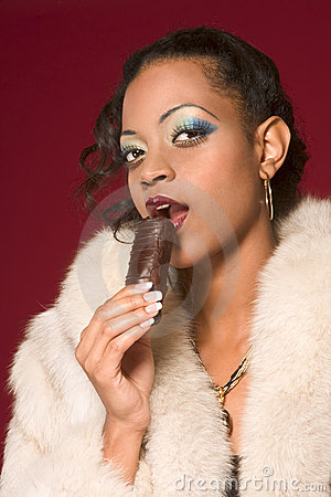 Free Girl In Fur Coat Eat Chocolate Royalty Free Stock Photography - 4464857