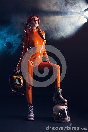 Free Girl In Orange Latex Catsuit With Helmet, Sci Stock Photography - 39861812