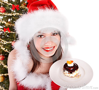 Free Girl In Santa Hat Eat Cake  By Christmas Tree. Stock Photos - 35353403