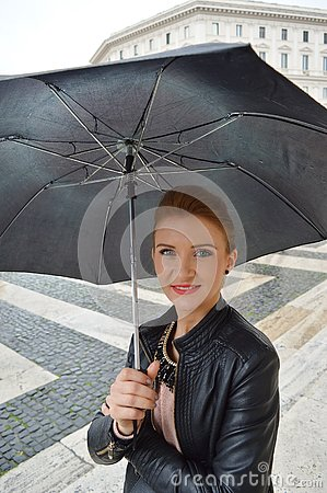 Free Girl In The City Walking In The Rain, Smiling Royalty Free Stock Image - 127397286