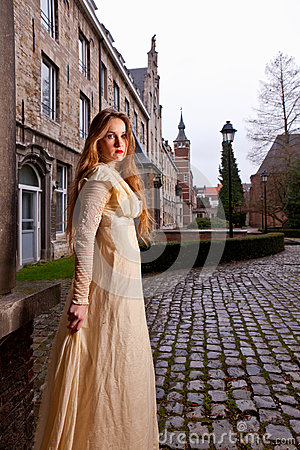 Free Girl In Victorian Dress In A Old City Square Royalty Free Stock Photography - 37446557