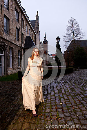 Free Girl In Victorian Dress In A Old City Square In The Evening Walking Stock Photo - 37446830