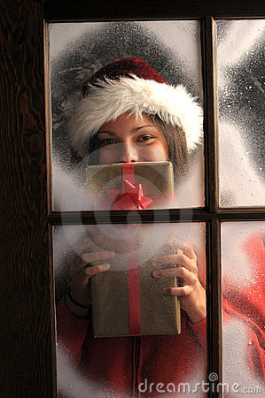 Free Girl In Window With Christmas Present Royalty Free Stock Image - 16598676