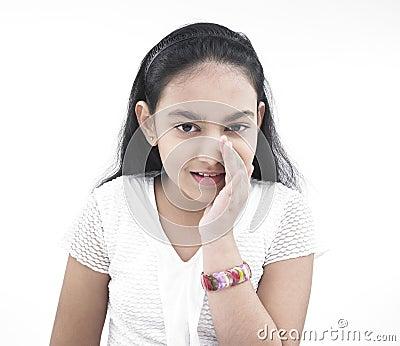 Girl of indian origin whispering