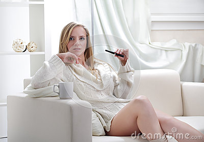 girl indoors with e-cigarette