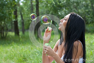 Girl inflates the bubbles