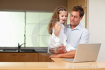 Girl is interested in her fathers laptop