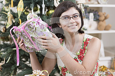 Girl is intrigued with Christmas gift