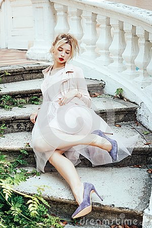 Free Girl Is Posing On The Stone Steps Stock Images - 106808684