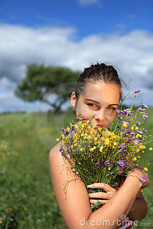 Girl iwith wildflower bouquet