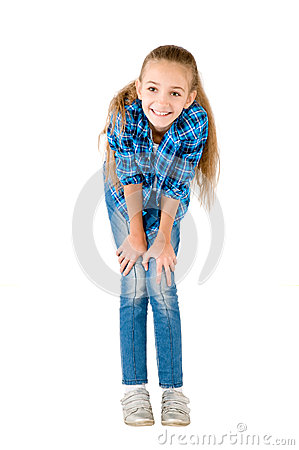 The girl in jeans and a checkered shirt