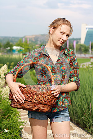 Girl in jeans shorts with basket